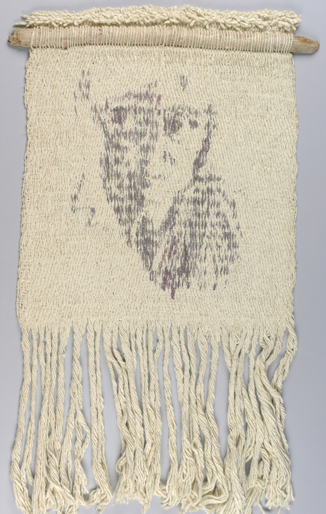 Woven in off-white with the dyed image of a face in grey/pink.