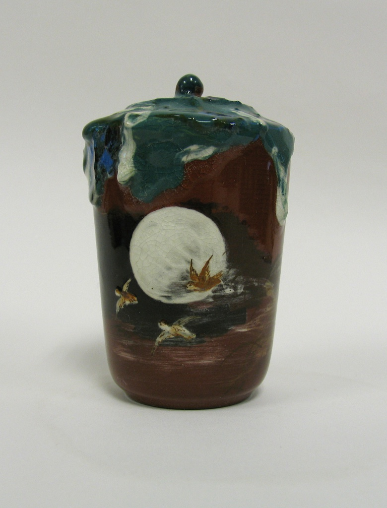 Miniature covered jar with moon, birds, and drip decoration.