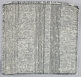 Warp: black and white rovana, Weft: black rovana and ivory asbestos. plain weave with change in alternating warp colors.