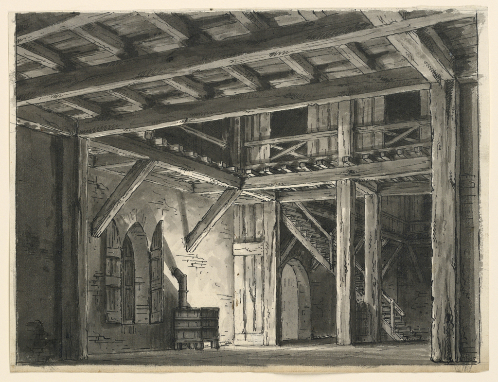 Horizontal rectangle. Interior of wooden barn with beam roof and stove. Staircase in background leads to exposed upper level.