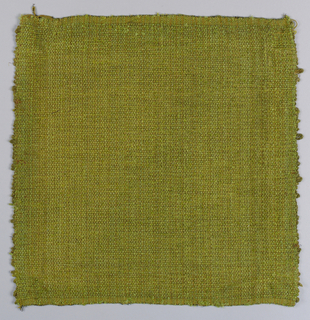 Hand woven sample in brown, green and gold fabric. Texture created by various yarns.
