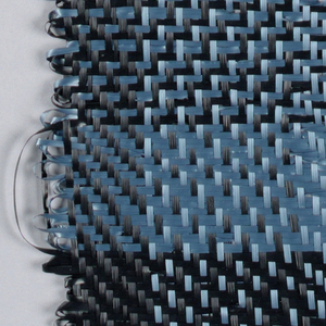 Warp: light blue and black rovana. Weft: light blue and black rovana. Striped warp and bands of weft - solid and toned checks.