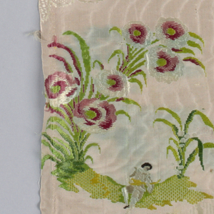 Fragment of pale pink silk moiré with white lace-like serpentines in supplementary weft patterning. Brocaded design of grass with large flowers; a youth, playing a mandolin, is seated on the grass.