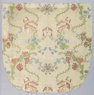 Incomplete cope hood in white silk figured with floral sprays and brocaded with symmetrical polychrome design showing serpentine plant stems with flowers.