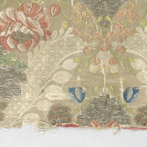 Two pieces of white or cream-coloured damask brocaded in rose, green and blue silk and silver metal thread. Large vertical repeat of symmetrically arranged flowers enclosed by ribbon-like bands - a/: backed with coarse linen, edged with metal ribbon and silver lace - b/: backed with coarse linen and edged with metal ribbon. b/: two piece put together in the middle.