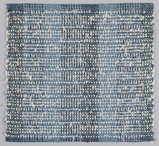 Warp: Blue and balck rovana; Weft: blue rovana and white asbestos. Plain weave with changes in warp colors for subtle stripes.
