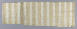 Fragment of linen fabric. White ground striped plain cloth and satin. Over plain cloth stripes are extra warps of yellow forming a small-scale, zigzag, conventionalized flower design.