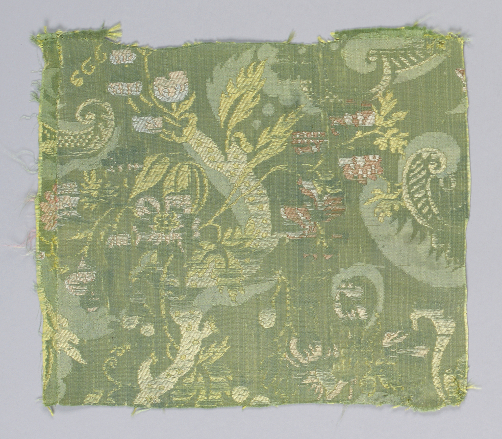 Green satin background with pattern – much worn away – of floral shapes in polychrome.