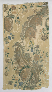 Fragment of taupe silk damask  in the 'bizarre' style, showing a design of meandering scroll with florals brocaded in metallic yarns and colored silks. One selvage present.