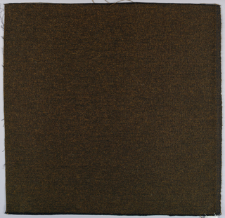 Square of upholstery fabric in black and brown.
