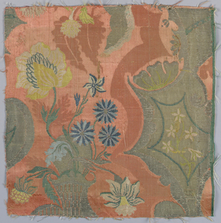 Fragment of brocaded silk damask in the 'bizarre' style. Pink, red and and silver ground with details brocaded in shades of blue showing a basket of flowers and fantastic shapes.