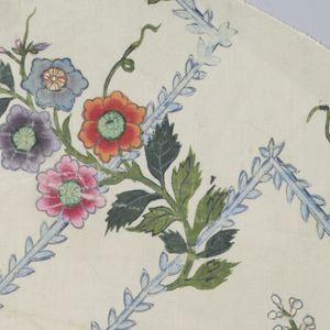 White ground with leafy blue zigzags and curling floral sprays in green, dark pink, purple, yellow, blue and orange.