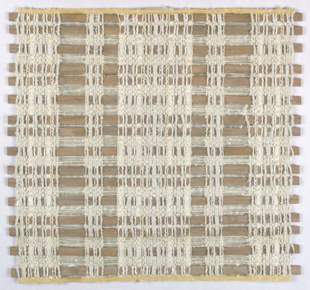 A and B are made of rigid asbestos strips of two differents widths woven together with textured white and cream-colored yarns which have a chenille-like appearance. C is the same except asbestos strips are an even width in a dark red-brown color.