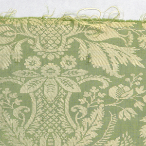 Vertically symmetrical pattern of flowers and leaves in off-white on a green background.