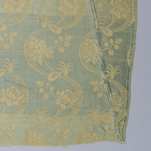 Ivory-colored silk with a monochrome pattern of S-meanders and stylized floral sprigs.