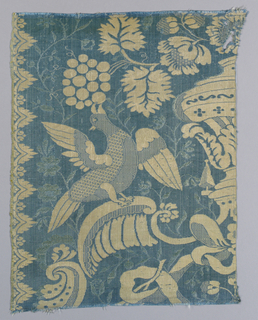 Blue and white design of bird reaching for grapes. This fragment is a match with 1902-1-842.