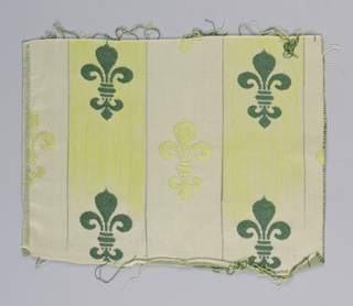 Upholstery fabric with alternating vertical stripes of chartreuse and white. Chartreuse stripes have dark green fleur-de-lys while white stripes have chartreuse fleur-de-lys.