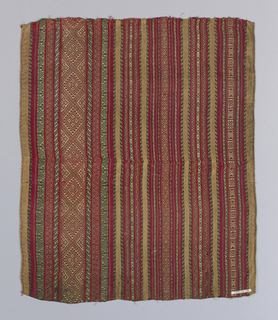 Ground striped horizontally red, tan, green, and purple with supplementary weft of gold metallic thread that forms geometric design over silk stripes.