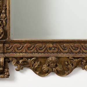 In ca. 1735 George II style. Tall, rectangular, with carved cartouche and broken-triangular pediment on top, above acanthus-decorated frieze, shaped base with putti below Vitruvian scroll banding. Pair with NA 5058.