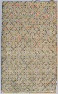 Ground divided into horizontally alternating quatrefoils and stars by rows of small leaves in extra black and white silk wefts. Background of gold. Within stars and quaterfoils conventionalized, small scale, symetrical flo-ral motifs in red , white and grey.