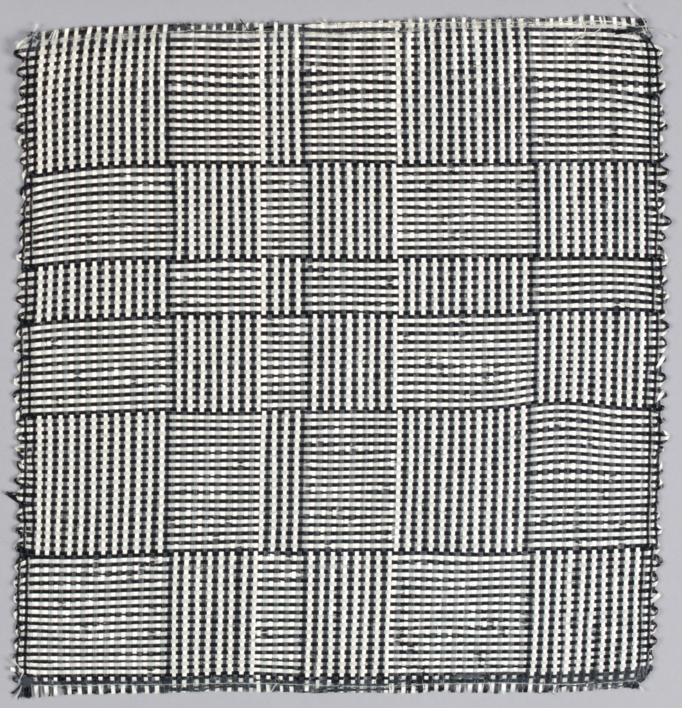 """Warp: black and white rovana. Weft: balck and white rovana. Changes in the alteration of black and white warps and wefts produce squares and rectangles sometimes called """"log cabin."""""""