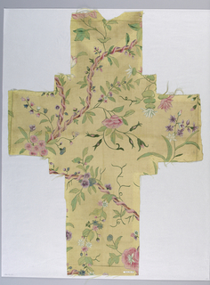 Fragment in the shape of a cross. Pale yellow ground has a design of serpentine brown branches interlaced with pink ribbon and bunches of flowers in various types and colors.