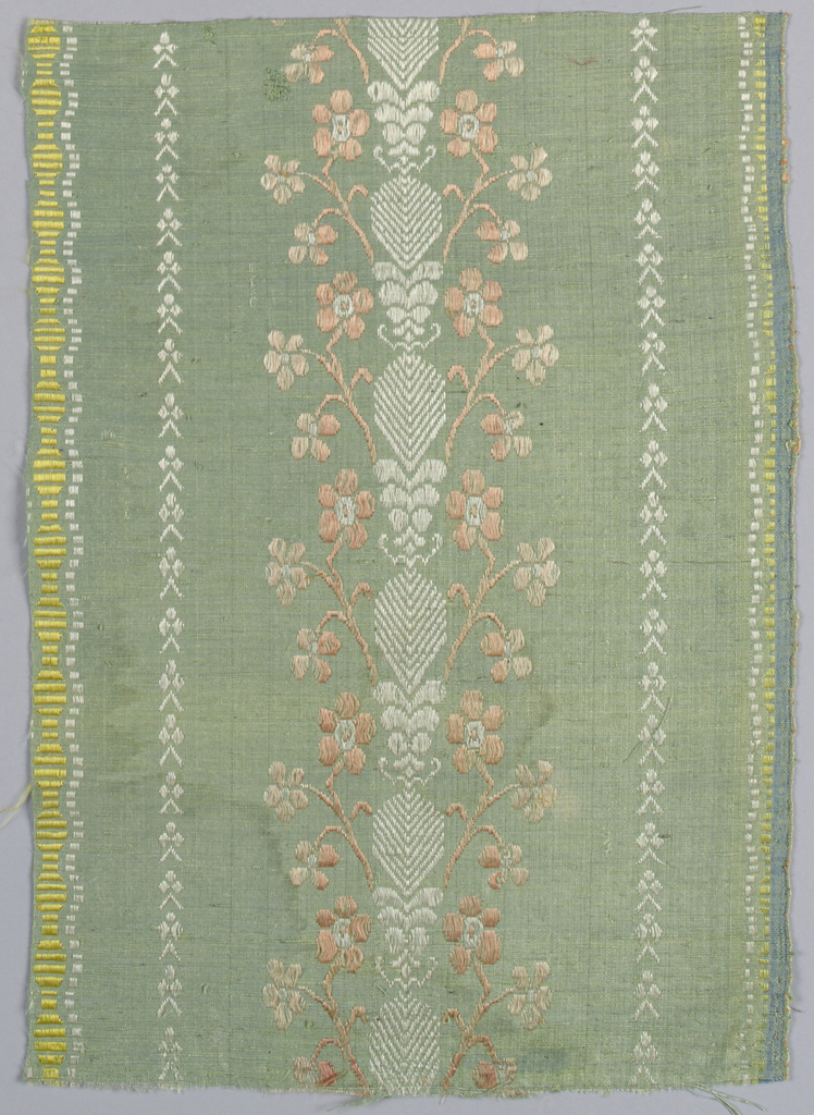 Light green ground with supplemenary silk warps in pink, rose, white and yellow forming pattern of vertical stripes and floral forms.
