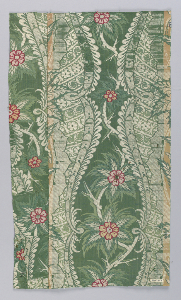 Fragment of woven silk showing vertical lace-like pattern with scallops in green and grey with pink and orange flowers on thorny stems. Piece made up of six fragments sewn together.