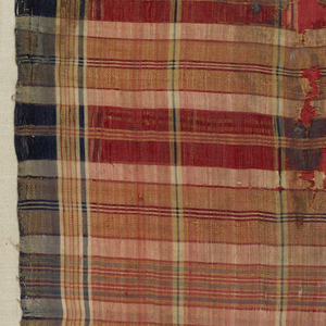 Fragments of woven silk in an irregular plaid in red with dark blue, tan and cream.