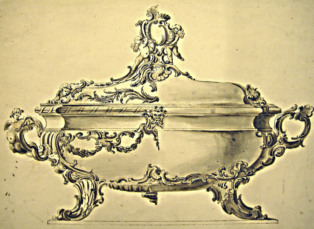 The left half suggests a much richer decoration--with rocaille and floral motifs--than the right one. The handle at left is composed of scrolls and a sea harp, the right one of scrolls and a shell. Two putti hold an escutcheon on top of the cover.
