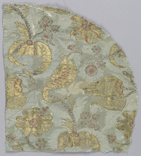 Pale blue damask with floral shapes and leaves in metallic silver, metallic gold and coral silk.