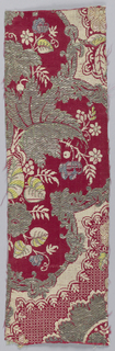 Textile fragment in the 'bizarre' style. Satin weave with patterning in supplementary warp pile (cut and uncut velvet) showing small portion of whole design showing  floral motifs in silver, green and white on a dark red field,  Elements of lace patterning.