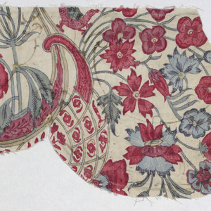 Fragment of a repeating pattern with flowers, rococo scrolls and animals. Fragment has been cut as for a valance.