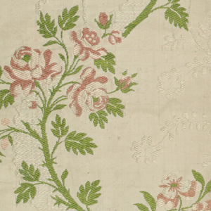 Fragment with serpentine floral sprays in green and rose on a white background patterned with lace-like bands and delicate foliage.