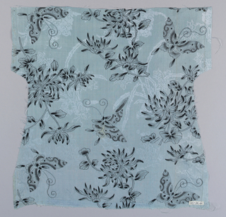 Soft sky-blue tabby with ground pattern of flowering plants in twill-effect. Stenciled flowering sprays and butterflies in black and  gray overlay this. One narrow coarse tabby selvage. Butterfly printed and painted. Flowers printed.