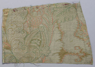 Fragments, somewhat related to the bizarre style, in cream and silver thread with red and green outlining. Densely patterned with curving stylized leaves and flowers.