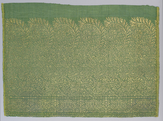 Border design of S-shaped foliate scrolls in gold on green.