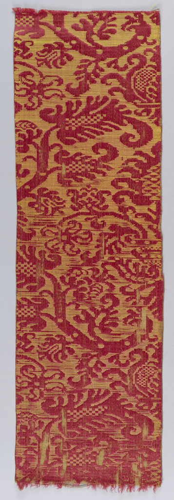 Brocatelle type with pattern of stylized stems and leaves reserved in red satin on a ground of gold produced by extra yellow silk wefts floated over the surface of the red satin.  Main wefts are coarse linen.