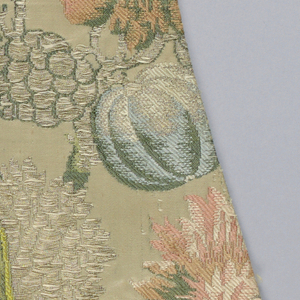 Polychrome design of broken branches with large fruits and flowers.