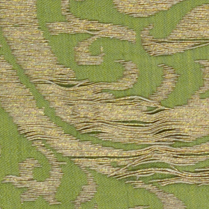 Green silk twill background with a design of serpentine stems with pomegranate blossoms and buds in gold and coral.