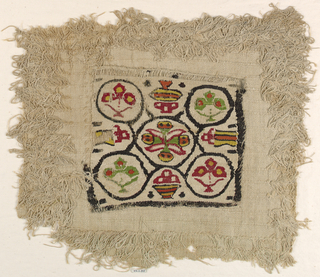 Square medallion sewn onto linen fabric with weft pile loops. The square has baskets, or bowls, containing fruits or flowers.