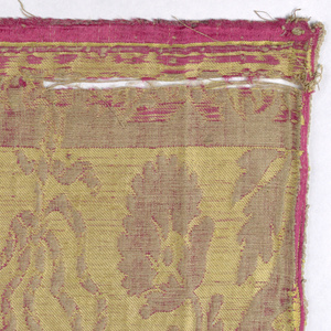 Horizontal border with a tassel motif. In red and yellow.