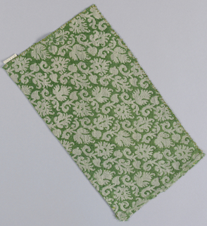 Rectangle cut on the bias of diagonal leaf branches in green white and silver.