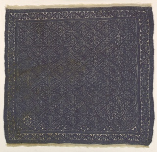 Monochrome tapestry square with an all-over design of twists and knots in deep purple.