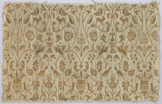 Fine lines forming cartouches containing birds and fountains. In brown and tan.