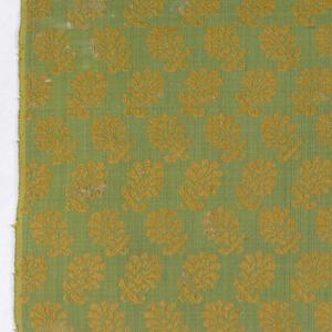 Detached leaf motifs in orange on green.