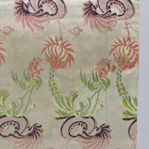 Off-white satin with large multicolored flowerheads and curving stems that show Chinoiserie influence.
