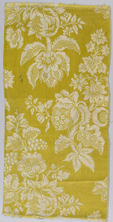 Woven silk damask showing yellow and white pattern of flowering plants.