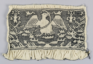 Smocked cuff embroidered in black depicting Mexico's coat of arms: an eagle perched on a prickly-pear cactus with a snake in its beak.