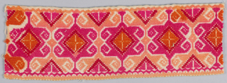Narrow border fragment, cotton, embroidered in all-over geometric cross-stitch pattern in orange, red and pink wool. Pattern is a modified star motif of Western European origin.